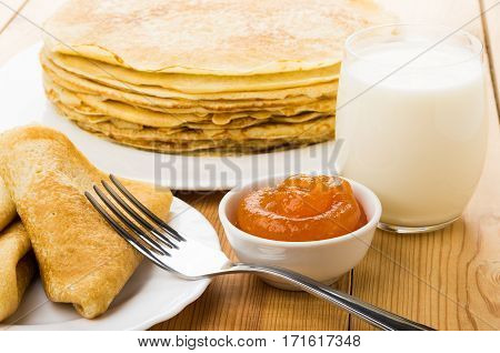 Russian Pancakes In Plate, Milk And Bowl With Peach Jam