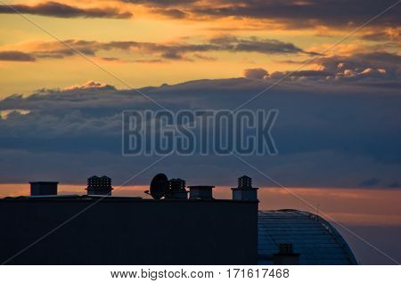 Colorful and picturesque clouds over city roofs at sunset in Belgrade, Serbia