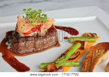 Closeup pan roasted beef tenderloin, lobster medallion