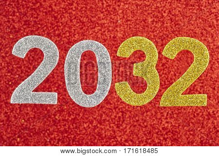 Number two thousand and thirty-two over a red background. Anniversary. Horizontal