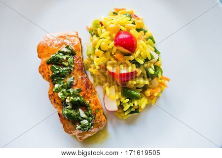 Fried salmon fish with rice and vegetables