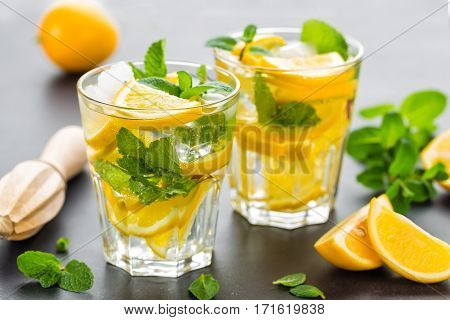 Lemon mojito cocktail with mint, cold refreshing drink or beverage