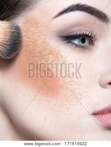 Beautiful female face closeup. Makeup. Make-up artist working. Girl with creative make up, detail.