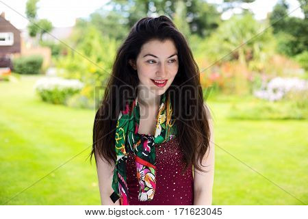 a portrait of a young woman in the park