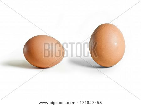 Image of brown eggshell on white background