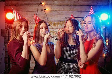 Girlfriend girls at the birthday party drinking champagne.