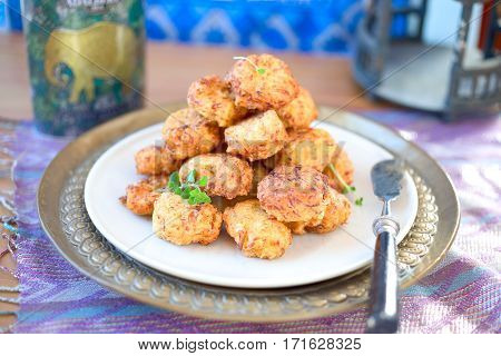 Stack of fried cabbage kofta-typical Indian food.