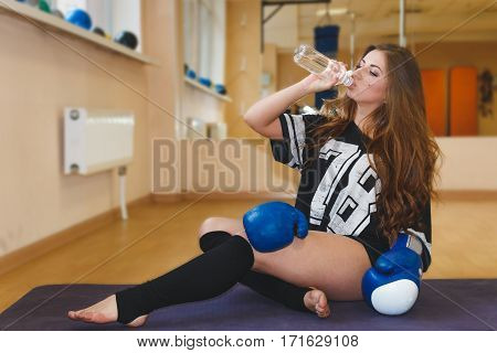 Fitness Woman Drinking Water From Bottle.