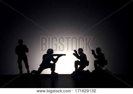 Soldier silhouette. Terrorism concept. Dark grey background