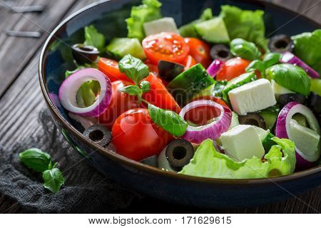 Healthy Greek Salad With Feta Cheese, Black Olives And Lettuce
