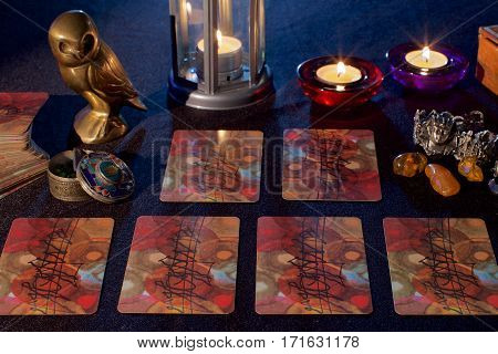 Background with tarot cards and candles on dark background