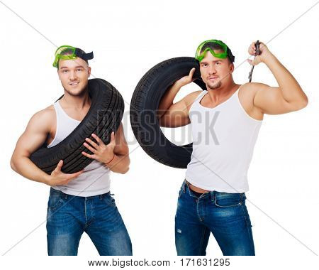 dancers dressed as car mechanics with wrench and tire, isolated against white background