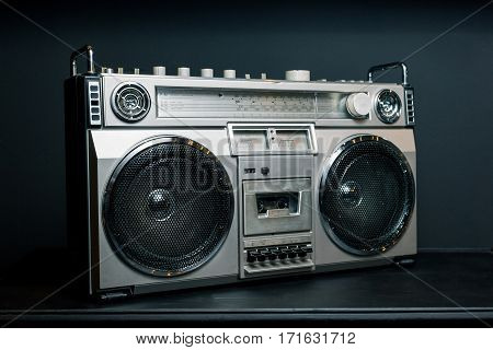 Vintage radio boombox on dark background .