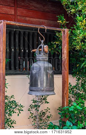 Ancient Metal Bell Hanging in Buddhism Temple