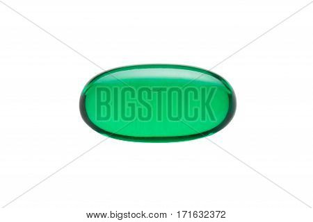 Green gelatin capsule or pill isolated on a white background. Medically themed studio macro with backlighting for extra pop.