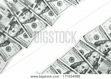 A border of American money isolated on white. Studio shot