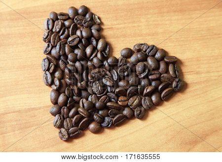 Coffee ground in form of heart close up