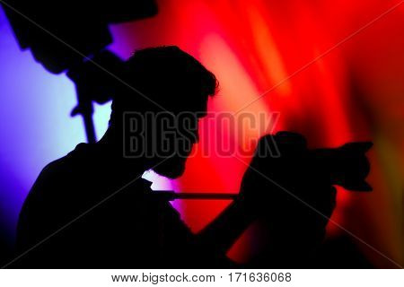 The Cameraman, Silhouette of Man with Video Camera at event