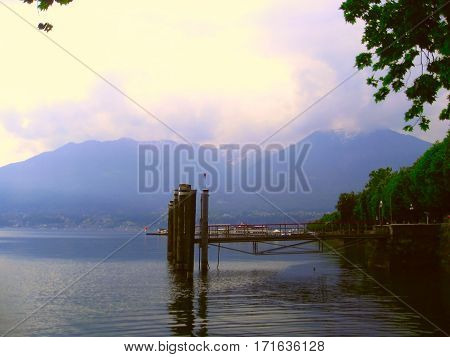 Lake Maggiore at sunset against the backdrop of the Alps the pier in Locarno Switzerland