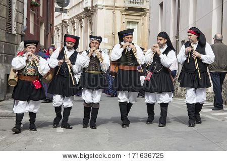 CAGLIARI, ITALY - May 1, 2013: 357 Religious Procession of Sant'Efisio - Sardinia - parade of musicians launeddas