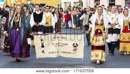 QUARTU S.E., ITALY - July 14, 2012: International Folklore Festival - 26 ^ Sciampitta - Sardinia - Parade of folk group Sa dom'e farra of St. Helens