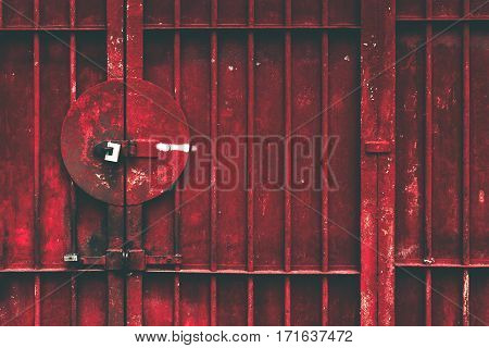 Bright red ply reshetchenaya door with padlocks and white sign prohibiting parking the concept of reliability Security Protected