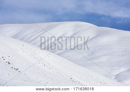 Snow Covered Hills with Blue Sky in Winter