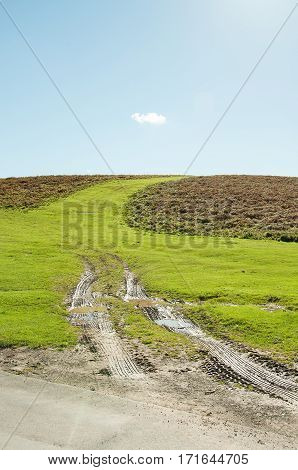Muddy tracks going up the hills in Wales.