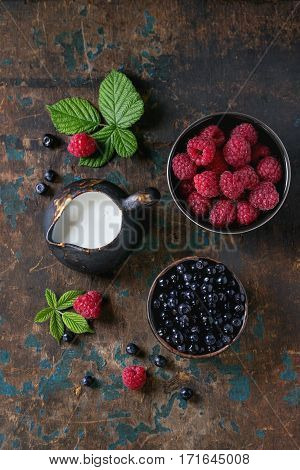 Bowls Of Raspberries And Blueberries