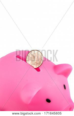 Piggybank bank United States one Cent coin and copy space