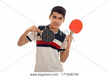 pretty brunette sports man practicing ping-ping isolated on white