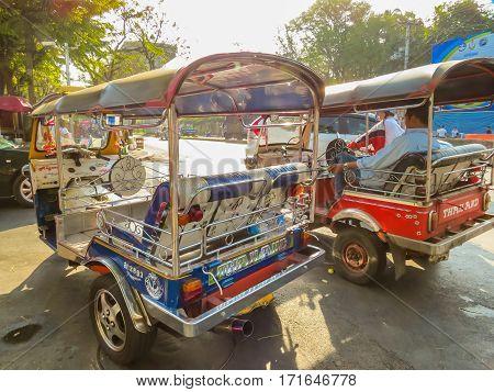 BANGKOK, THAILAND - JANUARY 16, 2014: Motor-taxi tuk-tuk on the street of Bangkok, Thailand