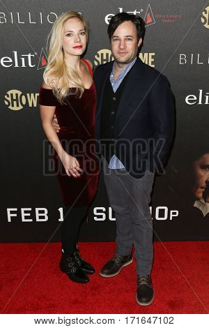 Actor Danny Strong (R) and Caitlin Mehner attends the