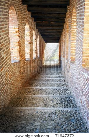 Ancient staircase in the Ducale castle in Vigevano (Lombardy, Northern Italy). Color image.