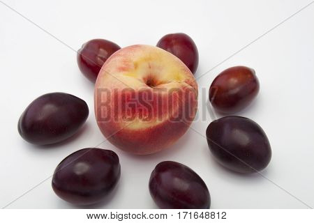 Peaches And Plums On A White Background