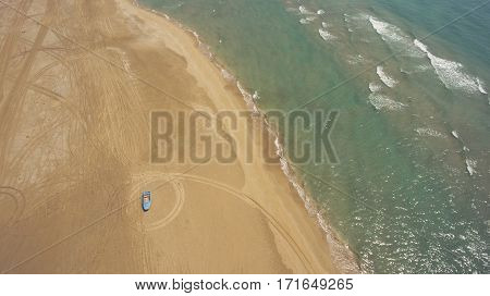 Aerial photo from flying drone of a beautiful nature landscape with blue sea with calm waves and boat on a sandy beach with copy space for your travel advertising. Amazing view on a Indian Ocean