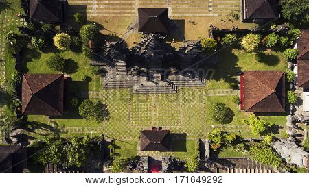 Top view aerial photo from flying drone of a traditional Bali temple with beautiful old architecture. Place for Buddhist worship in Thailand. Retro buildings for Hinduism religious