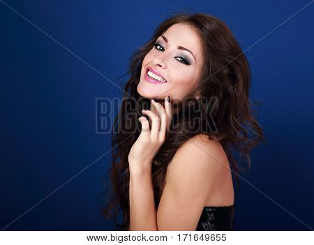 Beautiful Laughing Makeup Woman With Long Volume Hairstyle And Manicured Nails On Bright Blue Backgr