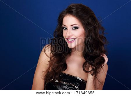 Beautiful Smiling Makeup Woman With Long Hairstyle Holding The Hand Her Hair On Bright Blue Backgrou