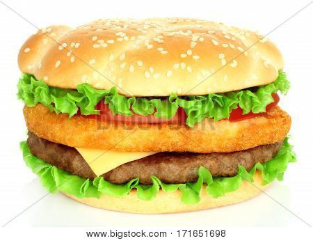 Big hamburger with chicken and beef cutlets on white background