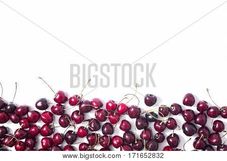 Red ripe cherry with water drops isolated on white background. Healthy eating