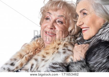 Senior woman hugged another while she smiling