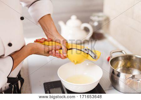 making custard on home kitchen with lemon juice