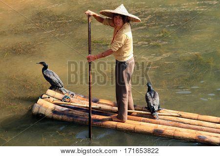 Yangshuo, China - Nov 5: Chinese Woman On A Bamboo Raft On The Li River, Guangxi Province, On Nov 5,