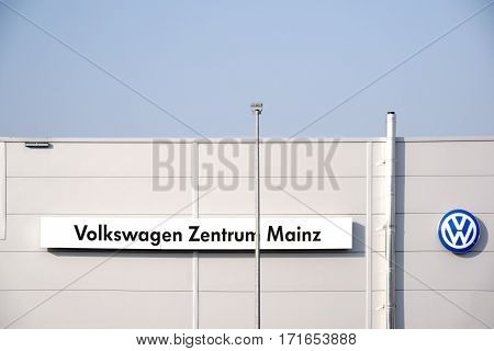 MAINZ, GERMANY - FEBRUARY 14: The facade and roof edge of the car buyer and the auto repair workshop Volkswagen Center with logo on February 14, 2017 in Mainz.