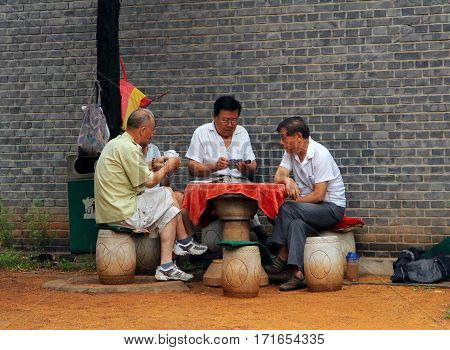 Beijing, China - Jul 17, 2011: Chinese Men Playing Cards In Jingshan Park, Not Far From Forbidden Ci