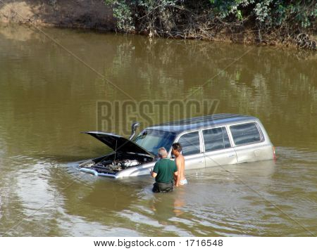 Car In The River