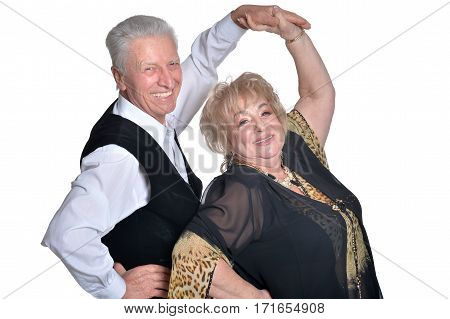 mature man and woman dancing against white