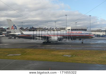 BOSTON - DEC. 25, 2014: American Airlines Boeing 757-200 at Boston Logan International Airport, Boston, Massachusetts, USA.