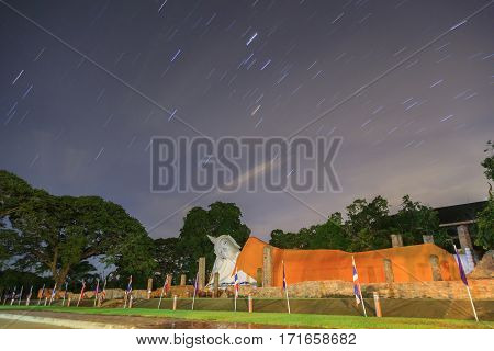 Startrail over big buddha image at Thailand